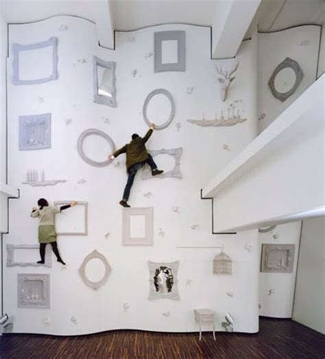frame design agency unworldly fitness climbing wall with odd challenges in