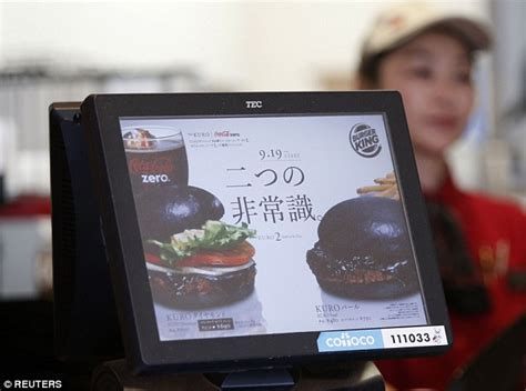 burger king kuro burger made with squid ink and bamboo