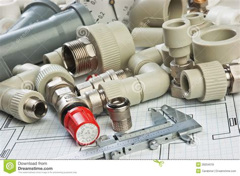 Stock Plumbing by Plumbing Fittings On The Drawing Royalty Free Stock Photos