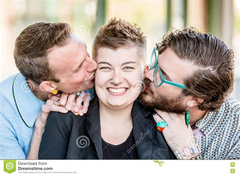 pics of genderfluid people two kisses with three people stock photo image 70710758