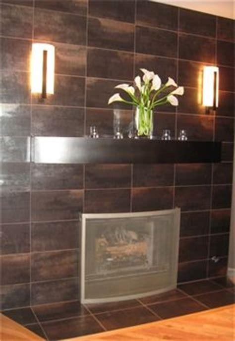 Metallic Tile Fireplace by Metallic Tile Fireplace With Custom Curved Metal Mantel