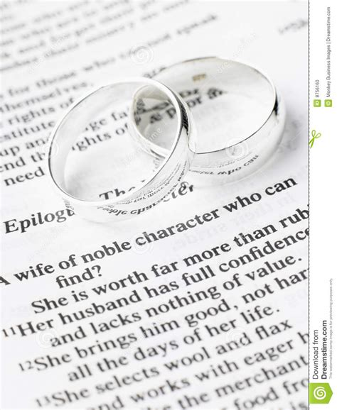 Holy Bible Wedding Verses by Wedding Rings Resting On A Bible Stock Photo Image 8756160