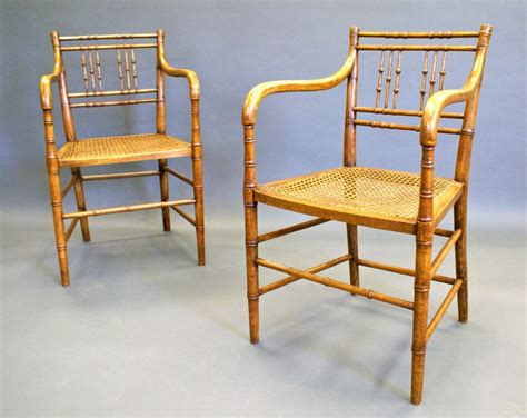 bamboo chairs a pair of regency faux bamboo arm chairs 291917
