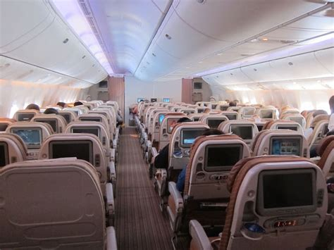 Lucky Rich Air Lounge qatar airways 777 economy going 10 abreast one mile at a