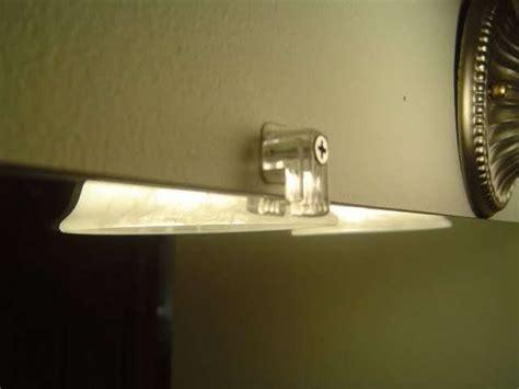 remove bathroom mirror clips installing a bathroom mirror