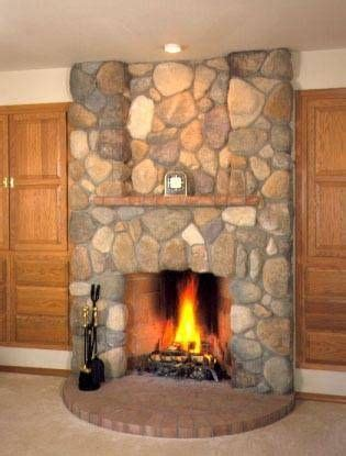 Rock Around Fireplace by How To Install River Rock On A Fireplace Surround