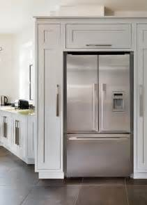 the cabinets around the fridge kitchen