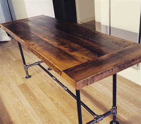 sofa table with pipe legs toronto s distillery district whisky racking harvest table