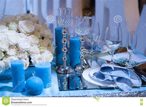 Wedding Decor Flower Candles by Wedding Decor In Blue Candles And Flowers On The Table