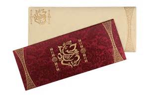 traditional ganesh wedding cards in royal crimson colour