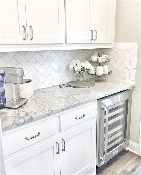 white tile kitchen backsplash wine fridge white cabinets grey counters home sweet