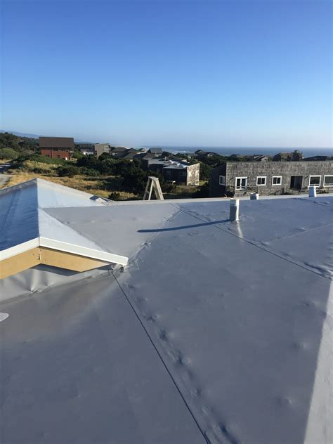 roofing oregon residential membrane roofing project oregon coast flat