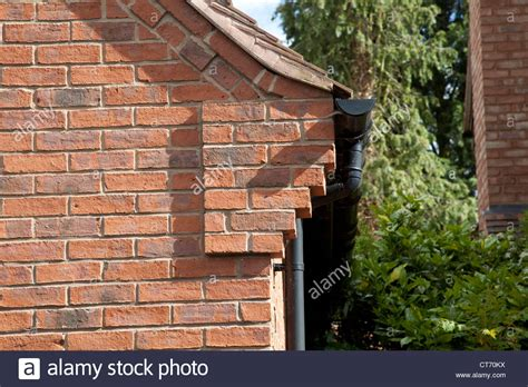 Corbelling Brickwork corbelling on corner of brick house on exclusive development near stock photo royalty free