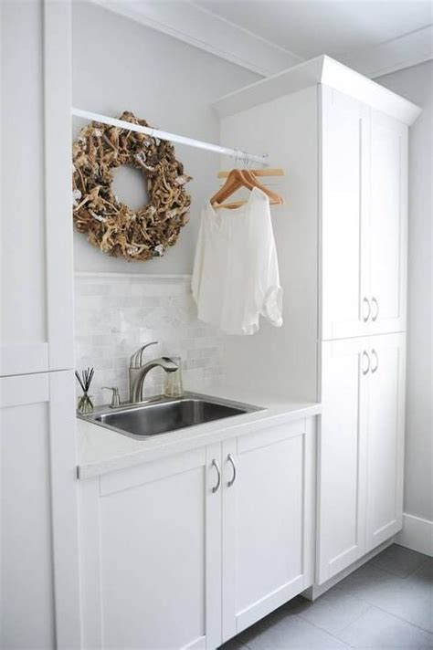 under cabinet drying rack white and gray laundry room features a stainless steel