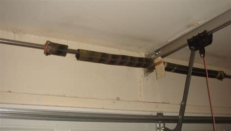 Garage Door Torsion Springs Beginners Guide Affinity Garage Door Broken Torsion