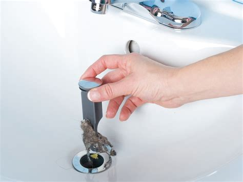 bathroom sink drain clogged fix common plumbing problems how tos diy