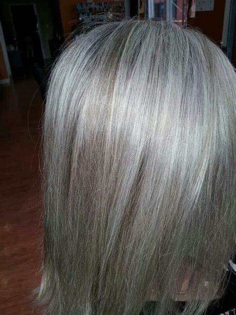 pictures of grey hair with lowlights transitioning to natural grey doesnt have to be so painful