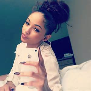 pics of black pretty big hair buns with added hair tyla marie
