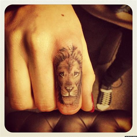 cara delevingne debuts new lion tattoo on her finger