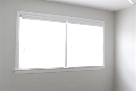 hanging curtains higher than window how to hang curtains to make your windows look bigger