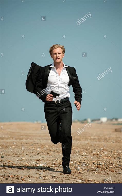 whos the black girl in the jogging suit in the liberty mutual commercial man in a black suit running after someone on the beach