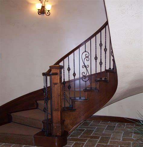 wrought iron and wood banisters wood railing with wrought iron balusters traditional