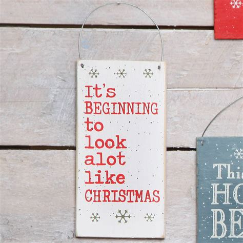 its beginning to look a lot like christmas chords its beginning to look a lot like christmas sign by red