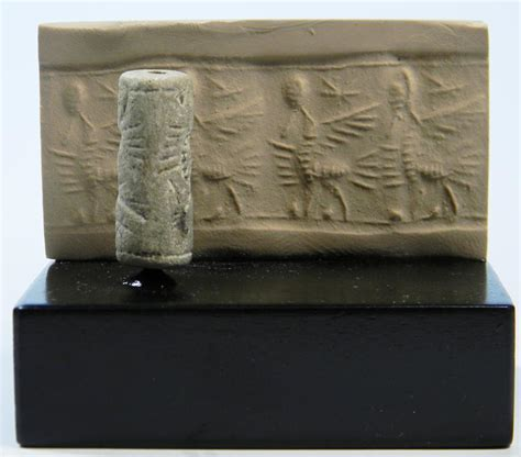 Seal Neo neo assyrian faience cylinder seal