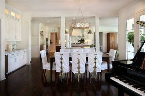 room covered in mirrors slip covered dining with
