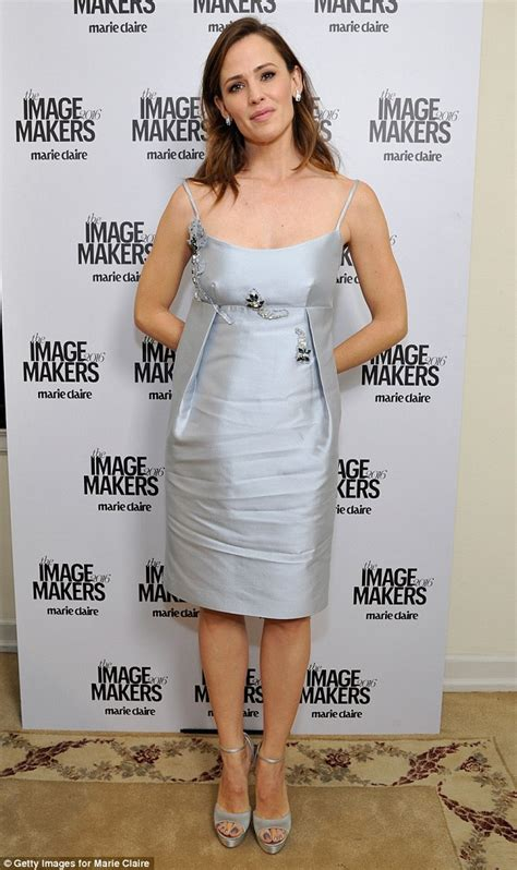 Jenifer Dress garner wears silver gown at s image