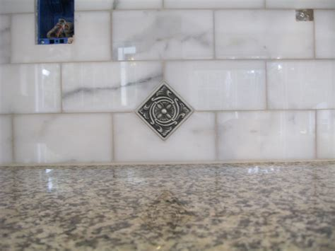 backsplash calacatta marble and antique pewter