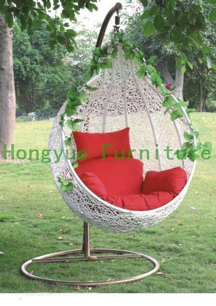outdoor white rattan garden swing chair  cushions