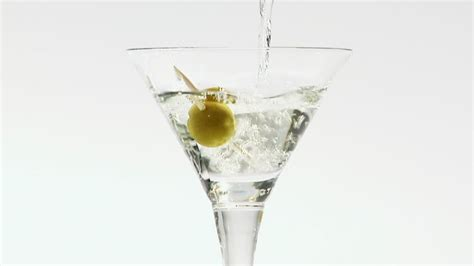 martini bianco glass aperitif martini pouring out hd stock video 587 494