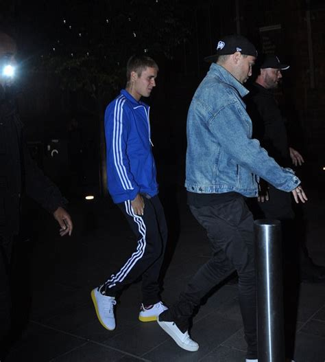 justin bieber wears a adidas x pharrell tennis hu sneakers jacket and in manchester
