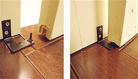 how do i stop a door from swinging open barn door guide with groove in bottom of door and metal