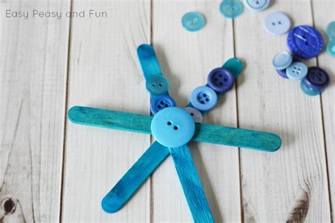 Making Christmas Ornaments - craft stick and buttons snowflake christmas ornament easy peasy and fun