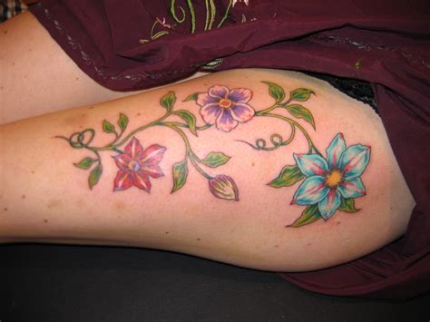 thigh flower tattoos feminine tattoos more