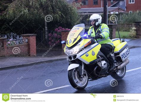 police motorbike escort  cycle race editorial stock