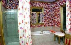 trading spaces flower bathroom trading spaces remember hildi s hot glued flower
