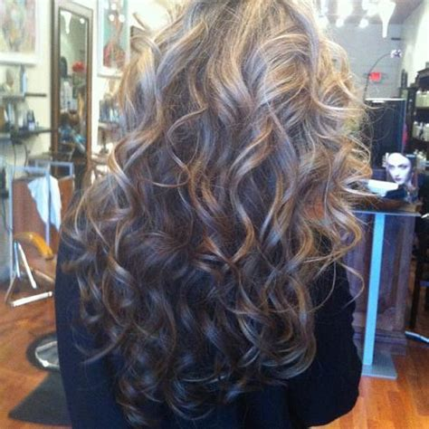 show me pictures of a perm with big rollers messy look hairstyles how to