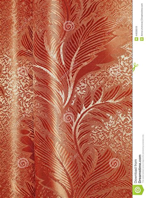 texture of red and beige satin patterned curtains with