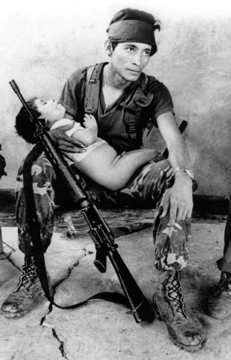 el salvador muertes por la guerrilla 1980 fmln solider tends to his child el salvadorian civil war