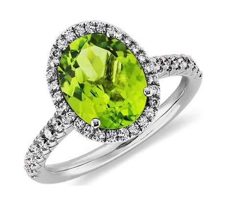 peridot and halo ring in 18k white gold 10x8mm