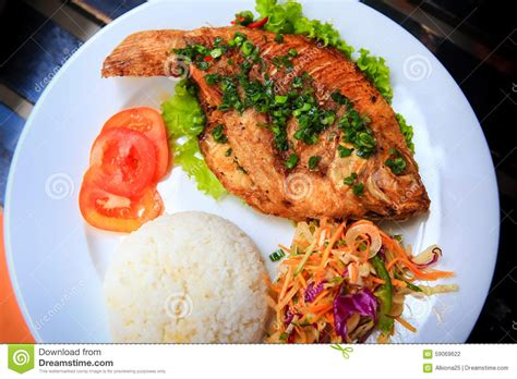 Fish Brown Rice And Vegetable Detox Diet by View Of Fried Fish With Rice Vegetables On White Plate