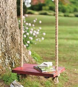 rope tree swing with wooden seat traditional