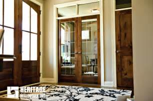 French Door Trim - knotty alder stained dark with white trim traditional