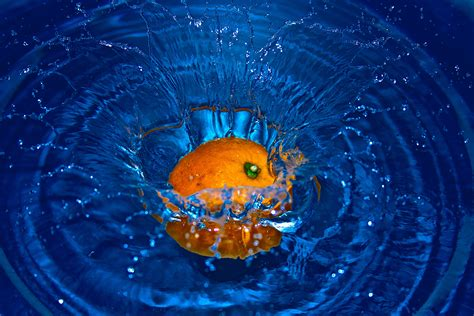 orange drop  water  time laps photography  stock