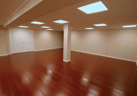 the millcreek synthetic wood basement flooring system - Hardwood Floor Basement
