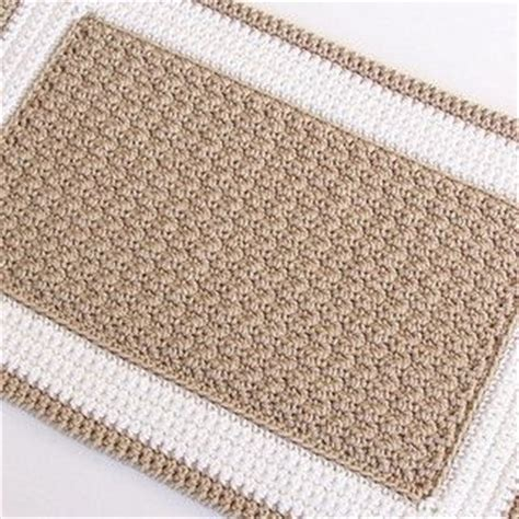 using a wash cloth as a bath mat beige and white crochet rug pattern by julie oparka rugs