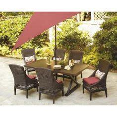 pembrey 9 patio dining set with lumbar pillows
